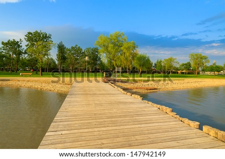 Wooden pier beach view at sunset, Neusiedler See lake, Burgenland, Austria - stock photo