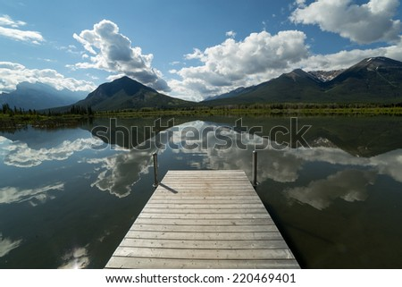 wooden pier in the morning on Vermilion lake in Banff, Alberta,Canada - stock photo