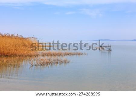 Wooden pier in tranquil lake Balaton-Hungary - stock photo