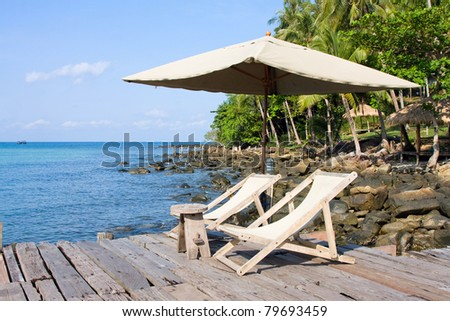 Wooden pier in tropical paradise - stock photo