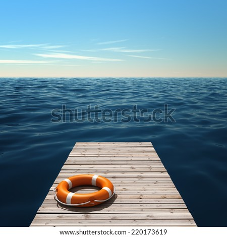 Wooden pier near the sea with lifebuoy - stock photo