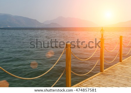 Wooden pier on a background of the sea landscape and mountains. Turkey. Marmaris