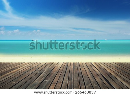 Wooden pier on the beach - stock photo