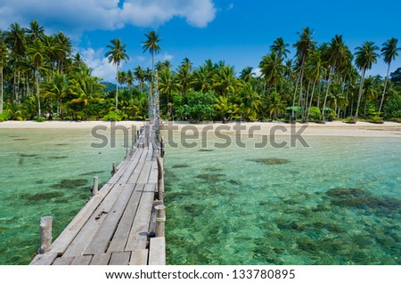 Wooden pier on the beach of Koh Kood island - stock photo