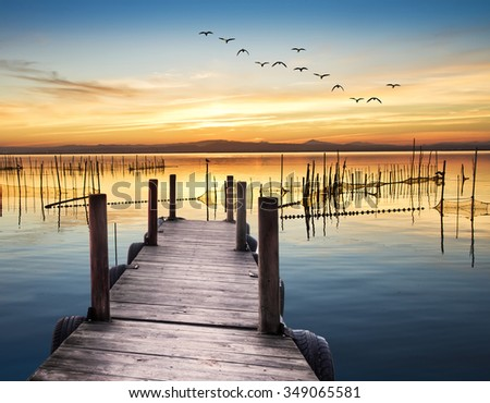 wooden pier on the lake - stock photo