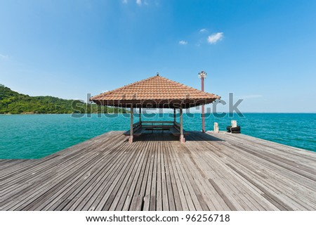 Wooden pier with pavilion in the sea, Thailand