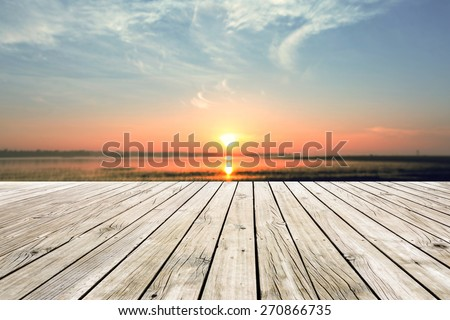 Wooden pier with sunset background  - stock photo