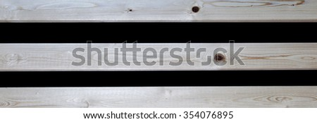 Wooden pine slats on black background texture, with knots - horizontal lines or stripes  in wood - panorama / header / banner. - stock photo