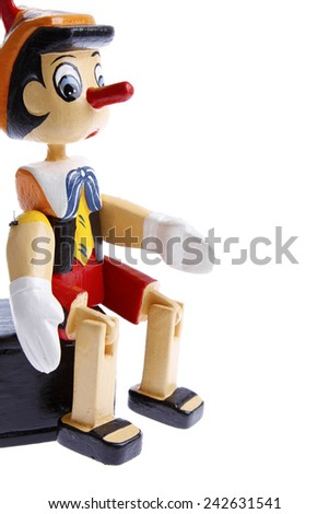 Wooden pinocchio on plain background - stock photo