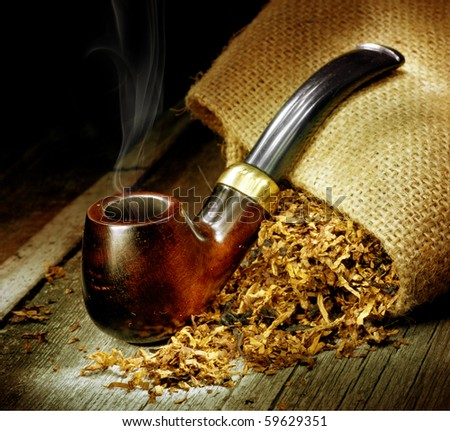 Wooden Pipe and Tobacco design.Over Black background - stock photo