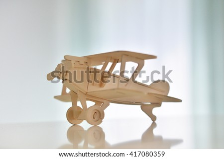 wooden plane is on the table - stock photo