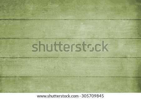 Wooden plank background texture in yellowish green hues. - stock photo