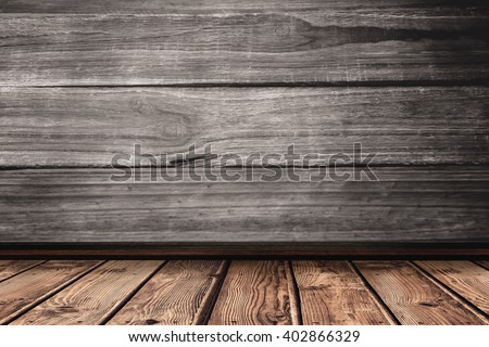 wooden planks against close-up of wooden flooring