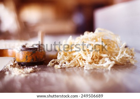 Wooden planks and shavings at carpenters workshop - stock photo