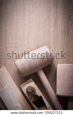 Wooden planks hammers planner on wood background copy space image construction concept.