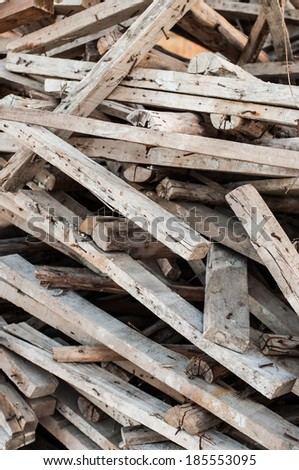 Wooden planks of a demolished house. - stock photo