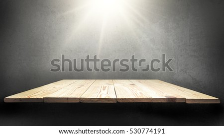 Wooden planks on background wall made of stone