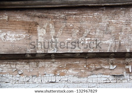 Wooden planks with cracked light paint