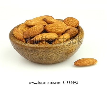Wooden plate with almonds - stock photo