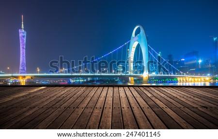 wooden platform and lights of night,guangzhou china. - stock photo