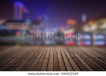 wooden platform and lights of night,shanghai china. - stock photo