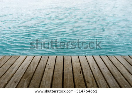 wooden platform  beside glitter sea wave Summer Style background - stock photo