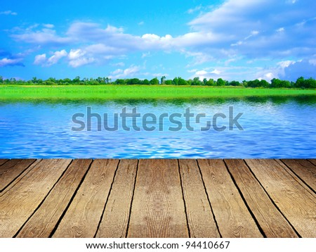 Wooden platform beside lake - stock photo