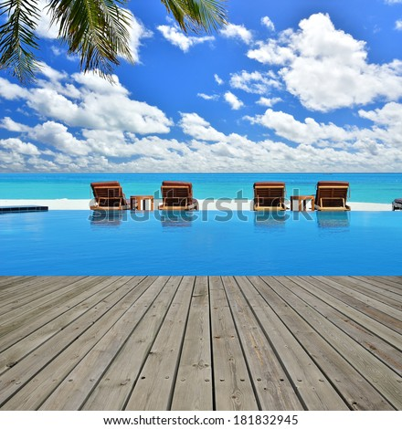 Wooden platform beside swimming pool in maldives beach resorts  - stock photo