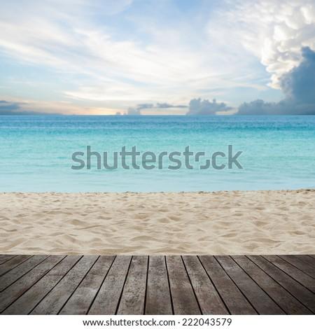 Wooden platform beside tropical beach - stock photo