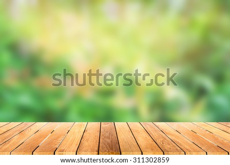 wooden platform with green blur bokeh background - stock photo