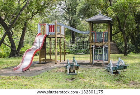 wooden play ground at the gardens area. - stock photo
