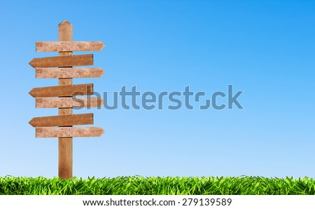 wooden pointer on the background Lawn in the clear sky. place in the sky can be used for text - stock photo