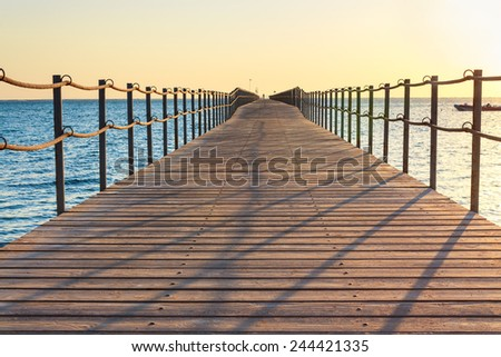Wooden pontoon stretching into the sea in Egypt