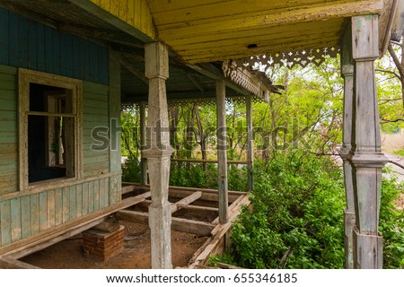 Wooden porch of an abandoned house