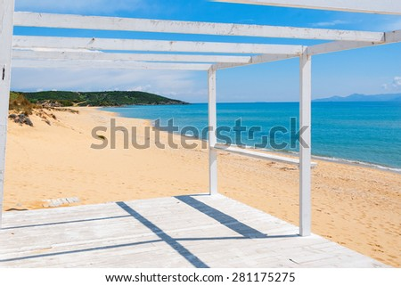Wooden porch on a beach looking to the sea - stock photo