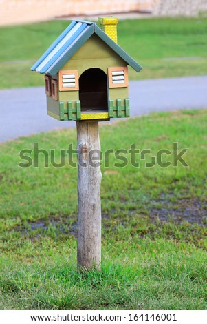 wooden post box in ranch field of farm house - stock photo