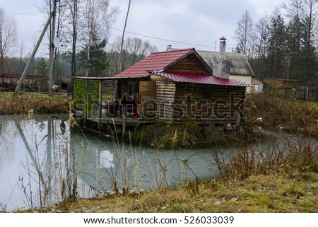 Wooden private house built on the shore of Lake
