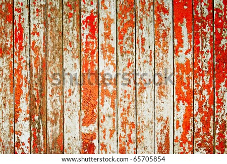 Wooden protection on all background, with traces of a red paint - stock photo