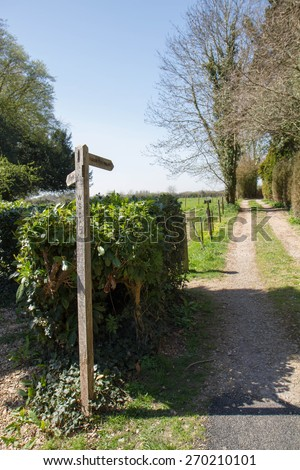 Wooden Public Footpath Sign at a crossroad - stock photo