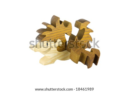Wooden puzzle in a form of hedgehog, without one piece - stock photo