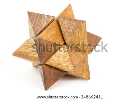wooden puzzle, isolated image composite wooden figures for the development of logical thinking.  - stock photo