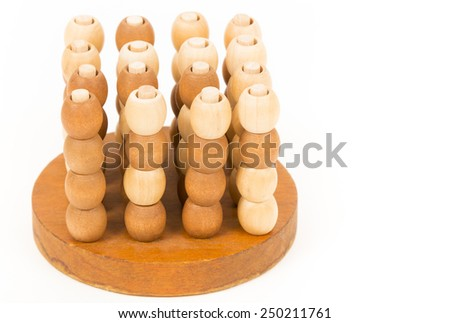 wooden puzzle, isolated image. composite wooden figures for the development of logical thinking.  - stock photo