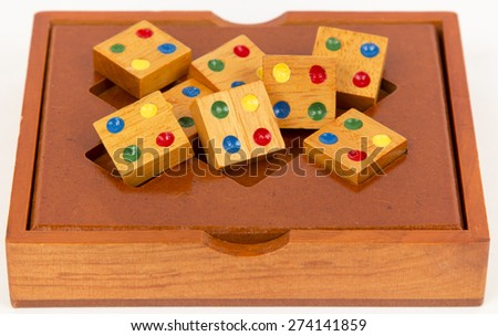 wooden puzzle, isolated imagecomposite wooden figures for the development of logical thinking - stock photo