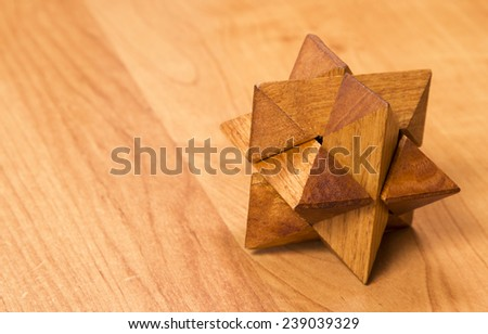 wooden puzzle on the table shot on camera  Canon EOS 650D, lens  Canon EF24-105L - stock photo