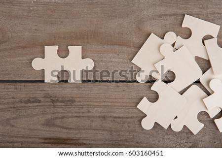 Wooden puzzle pieces on wooden background