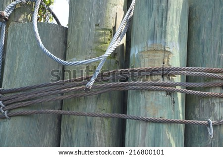 Wooden pylons at a dock for the ferry. - stock photo