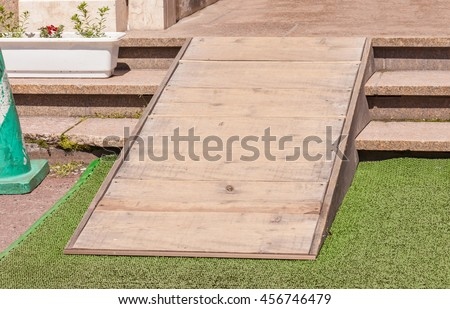 Wooden Ramped Access, Using Wheelchair Ramp For Disabled People.