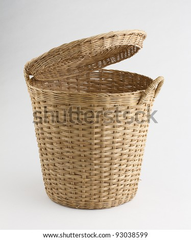 Wooden rattan basket the nice handicraft little cats playing around on the grey background
