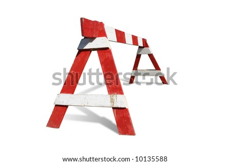 Wooden red and white striped road construction barrier - isolated on white - stock photo