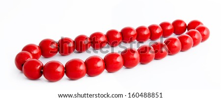 Wooden red beads isolated on a white background